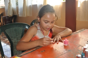 Cristi painting her nails.
